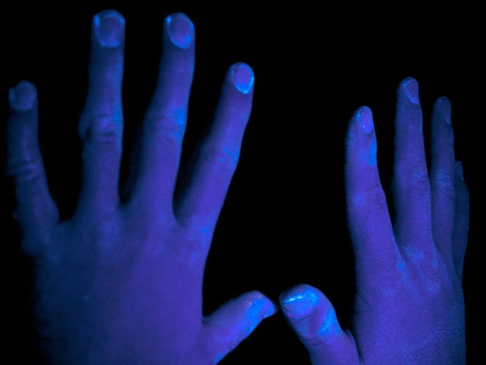Step 4: Check hands under UV light to show areas not washed properly