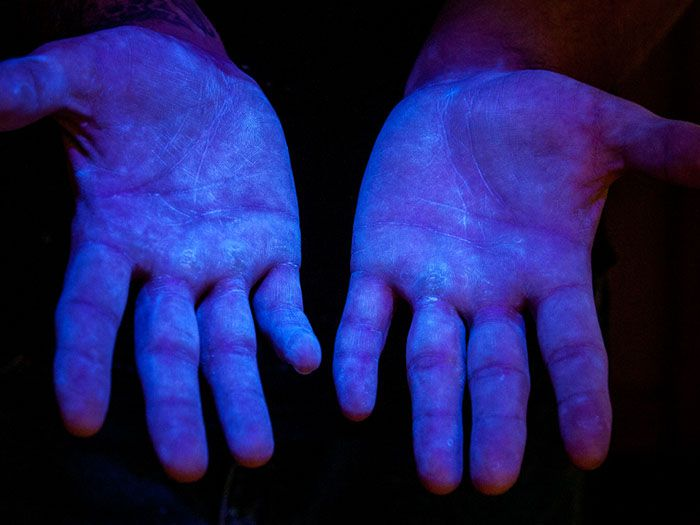 Step 2: Hold hands under UV light to show coverage